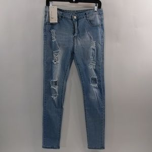 Light washed distressed stretch fit jeans